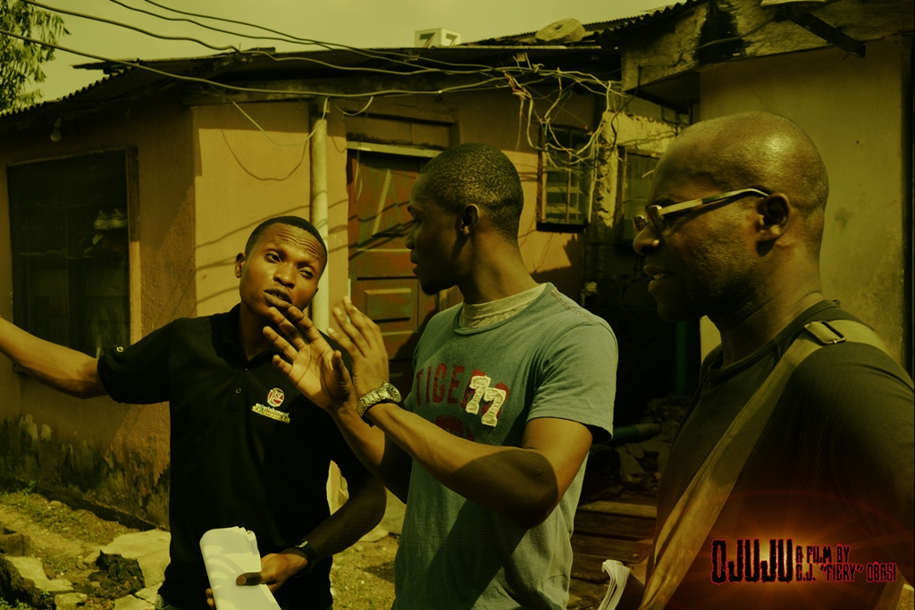 """Writer/Director C.J. """"Fiery"""" Obasi (center) on set with AD Frank Ekwem (left), and DOP Tunji Akinsehinwa (Right)"""
